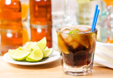 Cocktail with lime and cola Royalty Free Stock Images