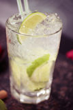 Cocktail with lime and ice Royalty Free Stock Image