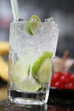 Cocktail with lime and ice. In a glass Royalty Free Stock Photography
