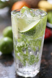 Cocktail with lime and ice. In a glass Stock Photography