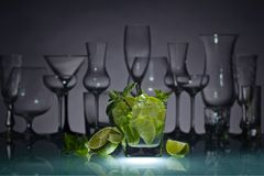 Cocktail with lime, ice and peppermint . Stock Image