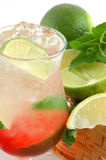 Cocktail with a lime and mint Stock Images