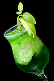 Cocktail with lime and mint closeup Royalty Free Stock Photos