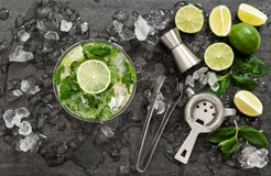 Cocktail with lime, mint and ice. Bar drink accessories Royalty Free Stock Photo