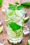 Cocktail with lime and mint Stock Images
