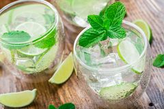 Cocktail with lime and mint Royalty Free Stock Images