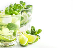 Cocktail with lime and mint on a white. Mojito cocktail with lime and mint on a white background Stock Image