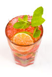 Cocktail with lime. Red cocktail with ice and lime Stock Image