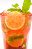 Cocktail with lime. Red cocktail with ice and lime Stock Images