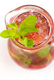 Cocktail with lime. Red cocktail with ice and lime Stock Photo