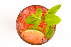 Cocktail with lime. Red cocktail with ice and lime Royalty Free Stock Image