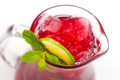 Cocktail with lime. Red cocktail with ice and lime Royalty Free Stock Images