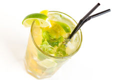 Cocktail with lime. Yellow cocktail with ice and lime Stock Images