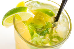 Cocktail with lime. Yellow cocktail with ice and lime Royalty Free Stock Image