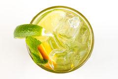 Cocktail with lime. Yellow cocktail with ice and lime Stock Photo