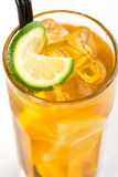 Cocktail with lime. Yellow cocktail with ice and lime Stock Image