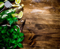 Cocktail - limes, rum, mint leaves, ice cubes Royalty Free Stock Photography