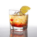 Cocktail with liquor and lemon Royalty Free Stock Image