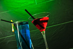 Cocktail and long drink with a green background Royalty Free Stock Photos