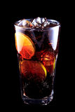 Cocktail Long Island Iced Tea on a black background. Stock Image