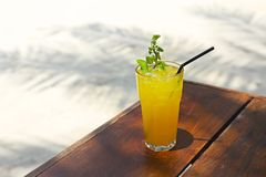 Cocktail Mai Tai with Light rum, dark rum, Orange Curacao, almond syrup, lime, ice cubes, pineapple and mint stock photo