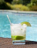 Cocktail Majito on edge by poolside Royalty Free Stock Photography
