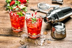 Cocktail making bar tools Red drink with ice royalty free stock images