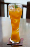 Cocktail, mango juice with ice cubes Royalty Free Stock Image