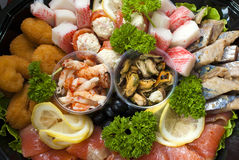Cocktail of marine food. Shrimp mussels herring surimi trout. Close-up Stock Images