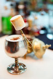 Cocktail with marshmallow in old metal goblet Stock Image