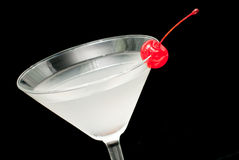 Cocktail in martini glass with red cherry closeup Royalty Free Stock Photography