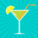 Cocktail in martini glass. Sunburst background. Royalty Free Stock Photography