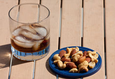 Cocktail And Mixed Nuts Stock Photos