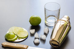 Cocktail Mixer lime slices and ice. Ingredients for Cocktail. Black Stock Images