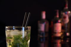Cocktail Mojito on a Bar with bottles Royalty Free Stock Photo