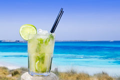 Cocktail mojito ice lemon straws in tropical beach. Balearic Islands Stock Images