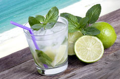 Cocktail mojito ice lemon straws in tropical beach Islands again Stock Photo