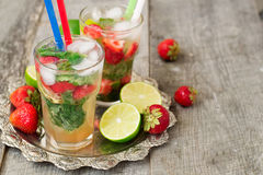Cocktail Mojito with strawberries - refreshing drink Royalty Free Stock Photo