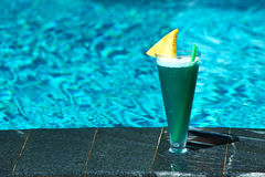 Cocktail near swimming pool Royalty Free Stock Image