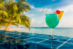 Cocktail near the swimming pool Stock Images