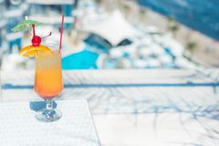 Cocktail near the swimming pool. The orange cocktail near the swimming pool Royalty Free Stock Photos