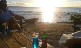 Cocktail no por do sol Imagem de Stock Royalty Free