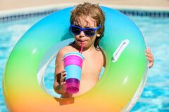 Free Cocktail On Watter Pool In The Summer. Funny Portrait Of Child. Kid Having Fun In Swimming Pool Outdoors. Children With Royalty Free Stock Images - 198192489