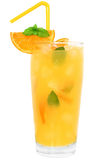 Cocktail with orange juice and ice cubes decorated leaf mint Royalty Free Stock Images