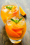 Cocktail. Orange juice with  mint and ice rustic Royalty Free Stock Photos