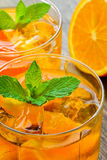 Cocktail. Orange juice with  mint and ice rustic Royalty Free Stock Photo