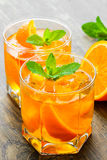 Cocktail. Orange juice with  mint and ice rustic Stock Images