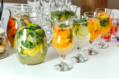 Cocktail with orange and mint. A few glasses. Royalty Free Stock Images