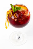 Cocktail with orange. Red cocktail with ice and orange Stock Photos