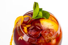 Cocktail with orange. Red cocktail with ice and orange Stock Photo